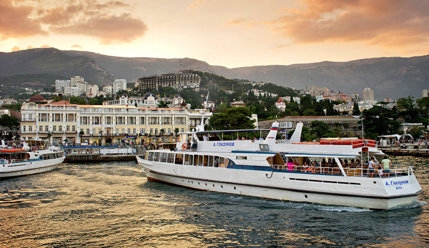 Pleasure cruisers and Yalta at sunset