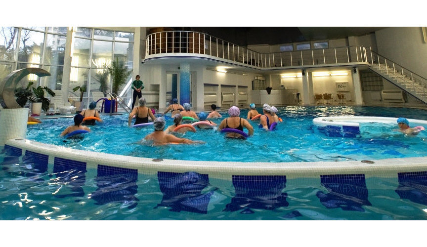 "Vacationers at water aerobics classes in the pool of the sanatorium ""Ai-Petri"""