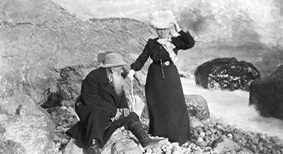 Leo Tolstoy and his wife on the beach