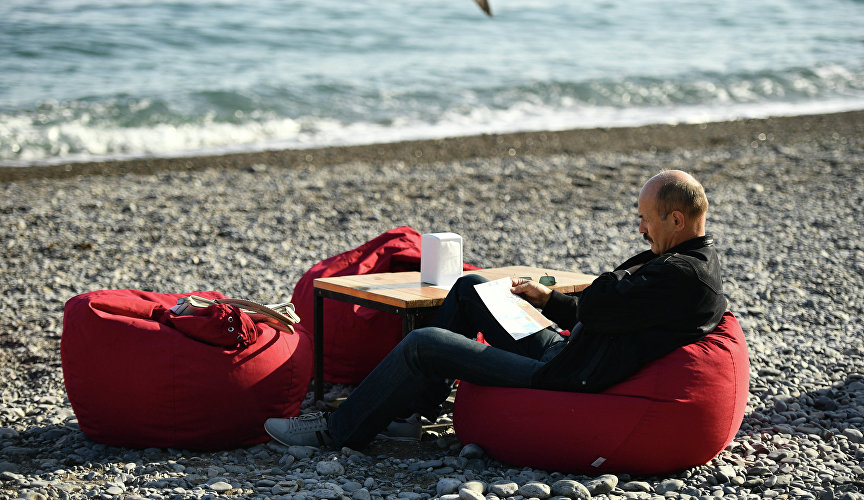 Man relaxing on the beach in Yalta