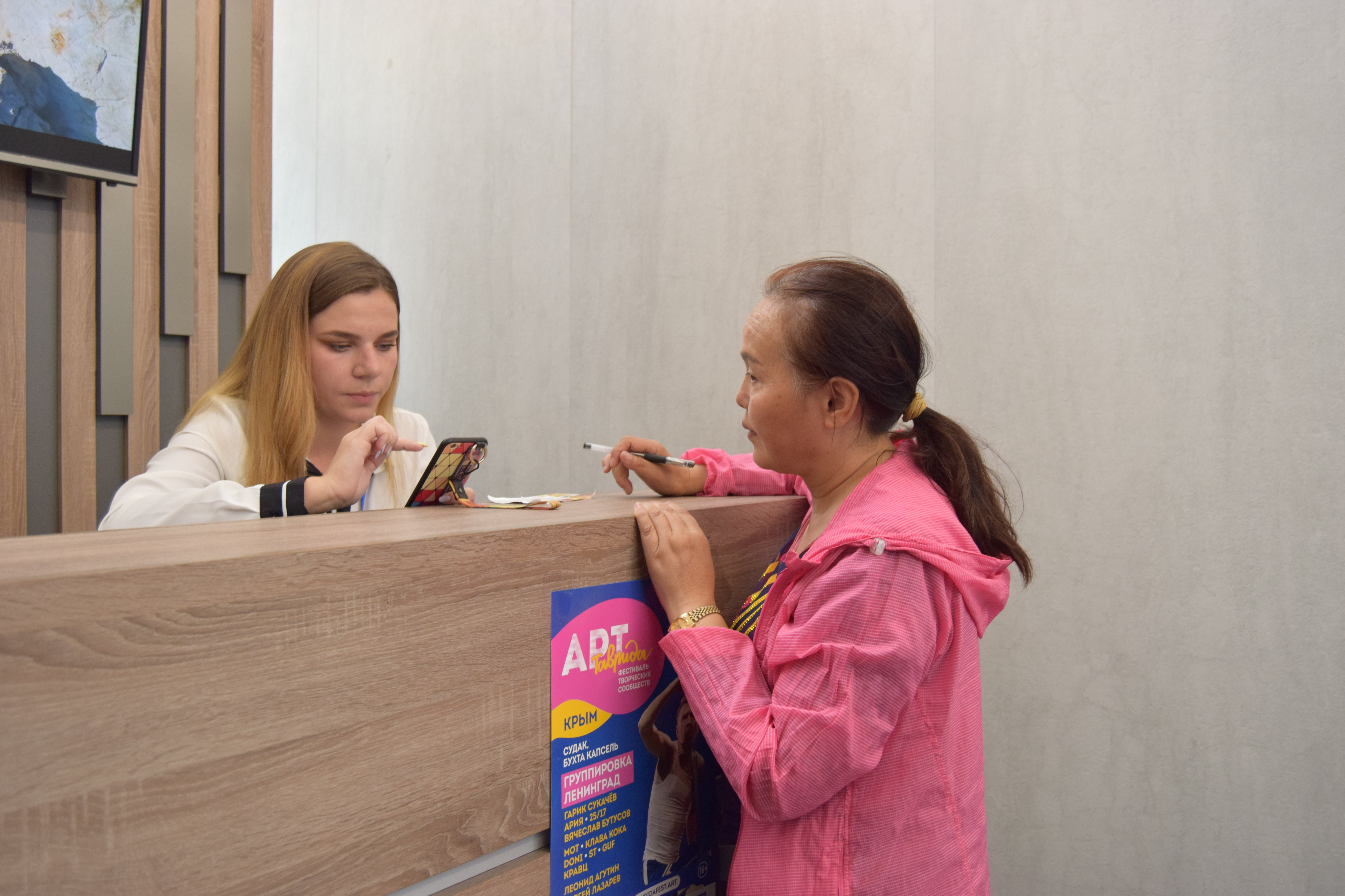 A tourist from China in the tourist information center at the airport of Simferopol