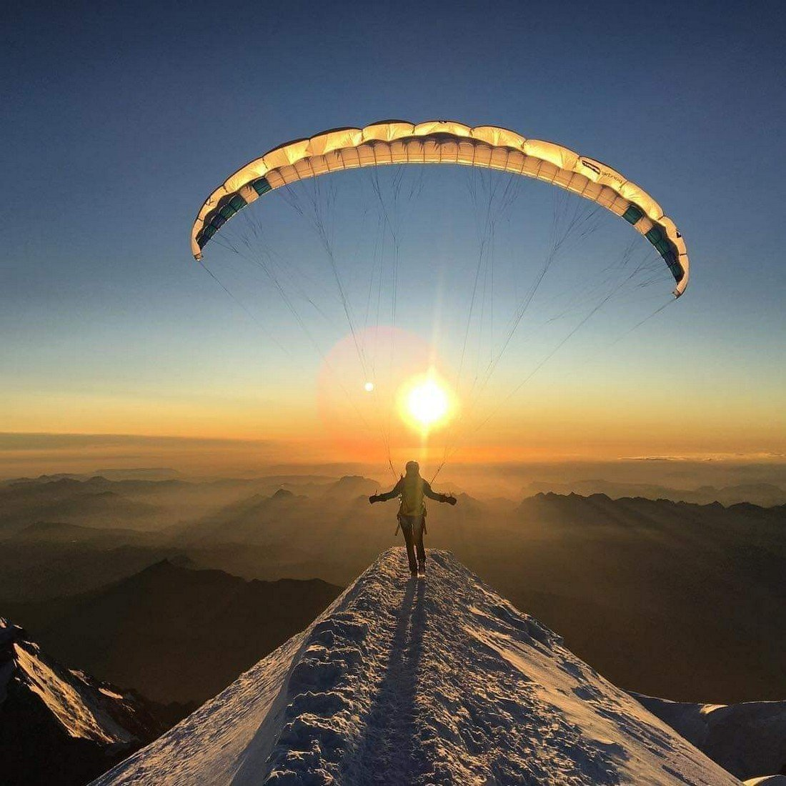 Paraglider in the mountains