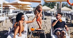 Family on the beach of the hotel Ribera Resort & SPA